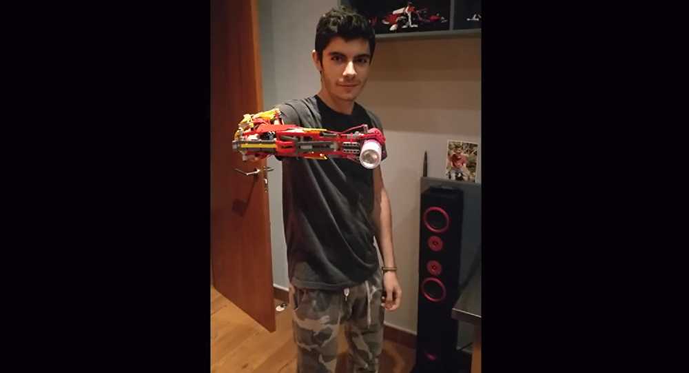 Andorran teen David Aguilar demonstrating the prosthetic Lego arm he built for himself
