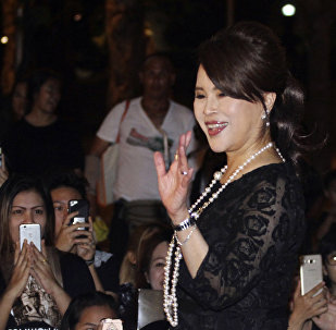 Thai Princess Ubolratana Mahidol waves to Thai people outside Grand Palace in Bangkok , Thailand. The selection of the elder sister of Thailand's king as a political party nominee for prime minister has upended a tradition of the palace playing no public role in politics. Most but not all modern monarchies steer clear of direct involvement in electoral politics or governing