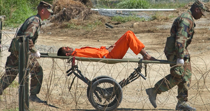 a detainee from Afghanistan is carried on a stretcher before being interrogated by military officials at the detention facility Camp X-Ray on Guantanamo Bay U.S. Naval Base in Cuba