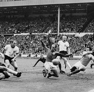 Gordon Banks (far right) makes a save during England's World Cup Final victory in 1966 against West Germany