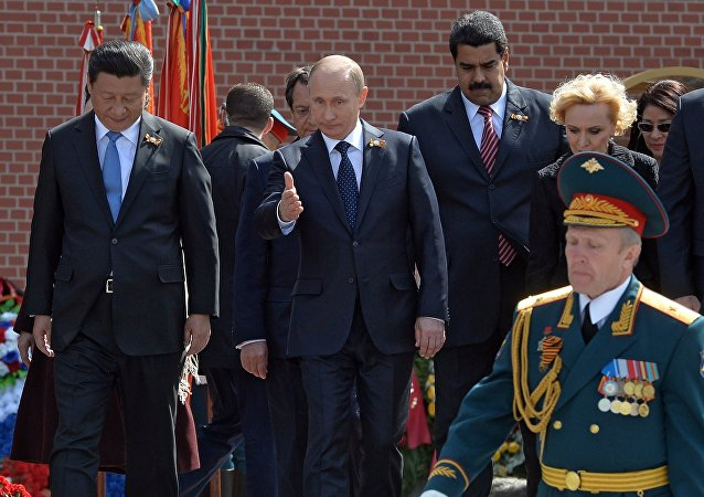 May 9, 2015. Russian President Vladimir Putin, 2nd left, at the flower-laying ceremony at the Tomb of the Unknown Soldier in Moscow's Alexander Garden. Left: President of the People's Republic of China Xi Jinping. 2nd right: President of Venezuela Nicolas Maduro