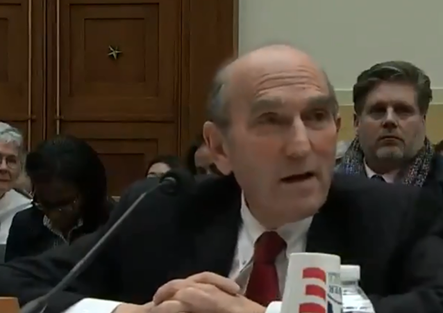 Elliot Abrams, the US special envoy to Venezuela, speaks with Minnesota Congresswoman Ilhan Oman during a House Foreign Affairs Committee hearing