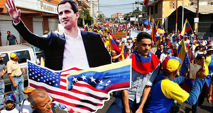 Opposition supporters carrying a cardboard cut-out of Venezuelan opposition leader Juan Guaido take part in a rally against Venezuelan President Nicolas Maduro's government and to commemorate the Day of the Youth in Maracaibo, Venezuela February 12, 2019.