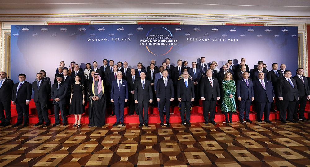 Participants pose for family photo at the Middle East conference at the Royal Castle in Warsaw, Poland, February 13, 2019