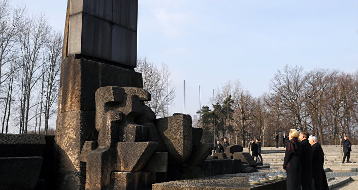 US Vice President Mike Pence with his wife Karen and Poland's President Andrzej Duda with first lady Agata Kornhauser-Duda stand at the Monument to the Victims at the former Nazi German concentration and extermination camp Auschwitz II-Birkenau, near Oswiecim, Poland, February 15, 2019.