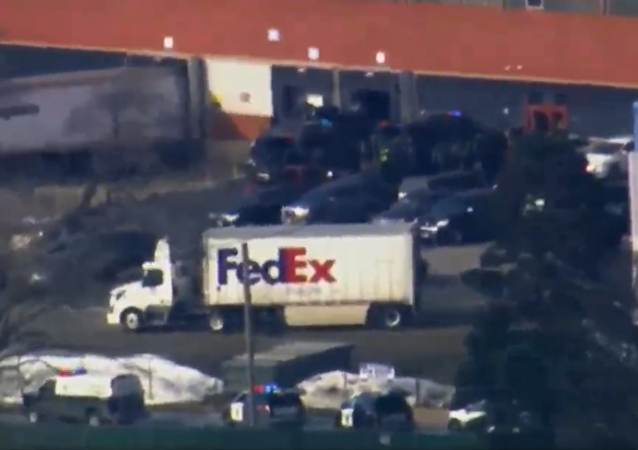 Police respond to active shooter reports at a warehouse site in Aurora, Illinois.
