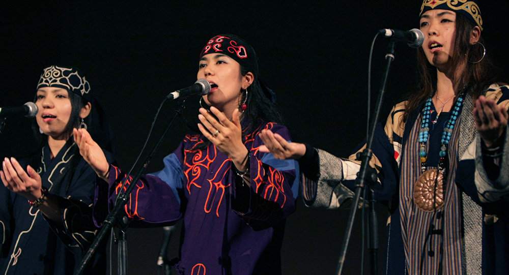 Ainu's Mina Sakai, center, performs in a concert of the Indigenous Peoples Summit in Sapporo, northern Japan