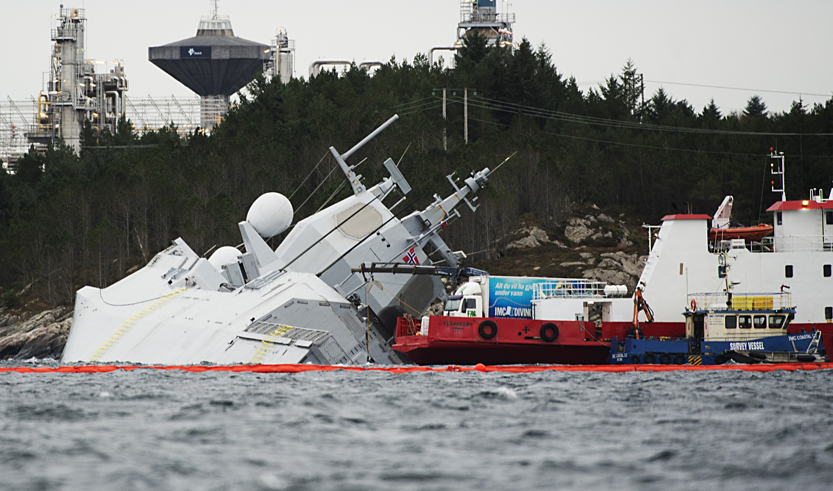 "The Norwegian frigate KNM Helge Ingstad takes on water after a collision with the tanker ""Sola TS"" on November 10, 2018 in the Hjeltefjord near Bergen"