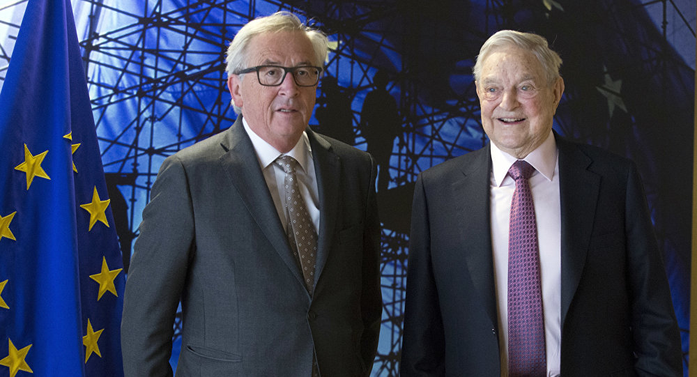EU commission President Jean-Claude Juncker, left, welcomes George Soros, Founder and Chairman of the Open Society Foundation, prior to a meeting at EU headquarters in Brussels on Thursday, April 27, 2017