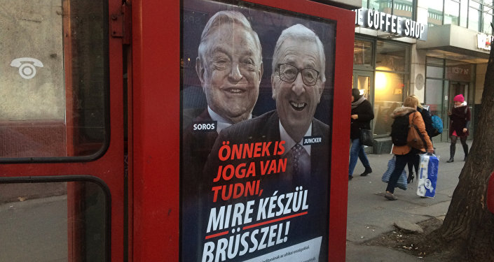 "A phone box displays a billboards showing Hungarian-American financier George Soros and EU Commission President Jean-Claude Juncker above the caption ""You have a right to know what Brussels is preparing to do!, on Vaci Avenue in Budapest, Hungary, Tuesday, Feb. 19, 2019"