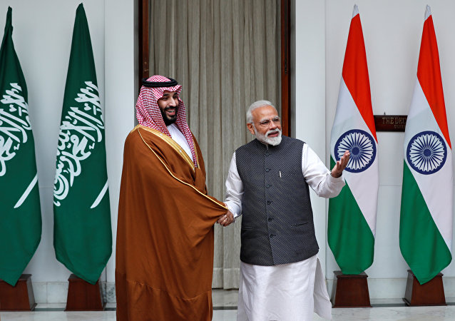 Saudi Arabia's Crown Prince Mohammed bin Salman shakes hands with India's Prime Minister Narendra Modi ahead of their meeting at Hyderabad House in New Delhi, India, February 20, 2019