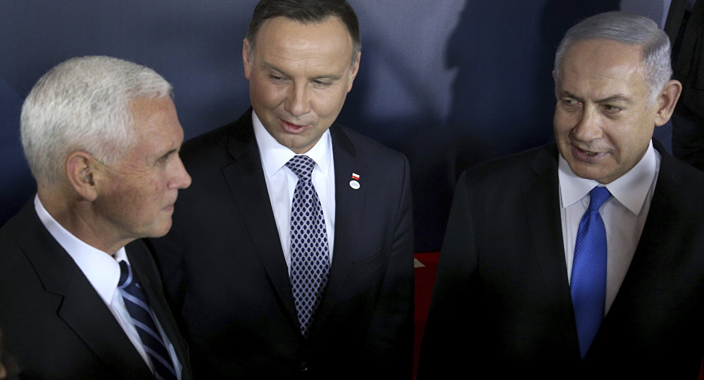 From left, United States Vice President Mike Pence, Poland's President Andrzej Duda and Israeli Prime Minister Benjamin Netanyahu talk after a group photo at the Royal Castle in Warsaw, Poland, Wednesday, Feb. 13, 2019