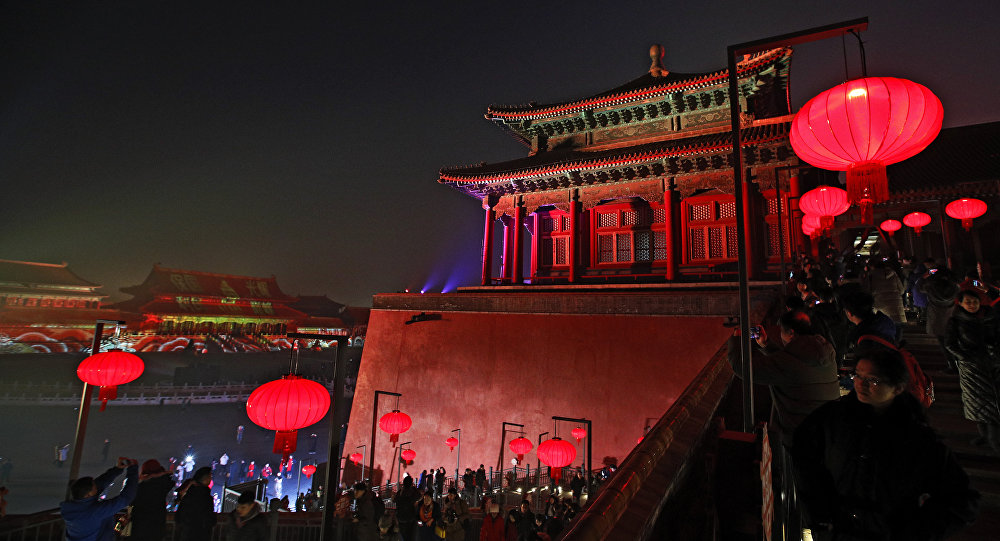 Visitors tour the Forbidden City decorated with red lanterns and illuminated with lights during the Lantern Festival in Beijing Tuesday Feb. 19 2019