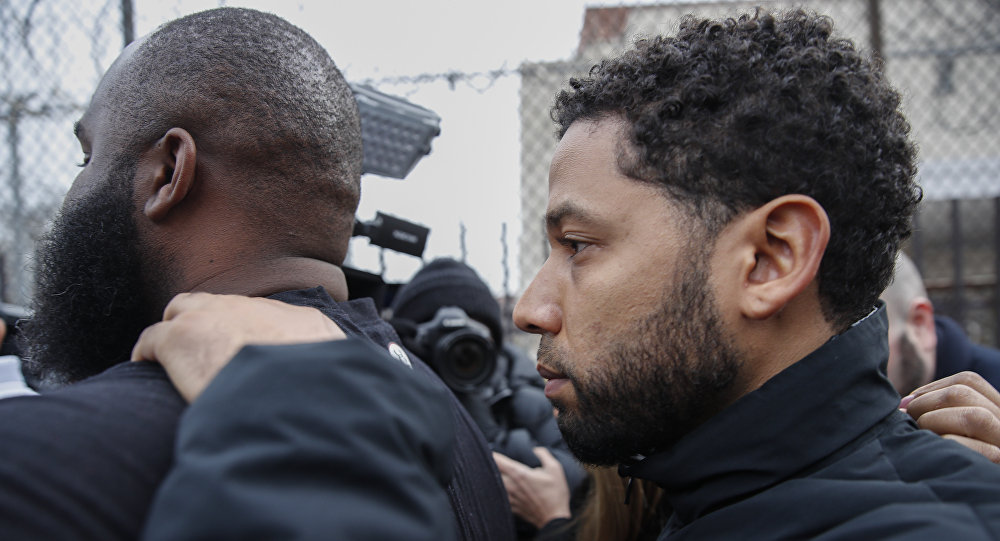 Empire actor Jussie Smollett leaves Cook County jail following his release, Thursday, Feb. 21, 2019, in Chicago. Smollett was charged with disorderly conduct and filling a false police report when he said he was attacked in downtown Chicago by two men who hurled racist and anti-gay slurs and looped a rope around his neck, a police official said