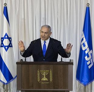 Israeli Prime Minister Benjamin Netanyahu gestures as he delivers a statement in Ramat Gan, Israel, Thursday, Feb. 21, 2019.