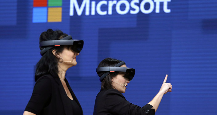 FILE- In this May 11, 2017, file photo, members of a design team at Cirque du Soleil demonstrate use of Microsoft's HoloLens device in helping to virtually design a set at the Microsoft Build 2017 developers conference in Seattle. Federal contract records show the U.S. Army has awarded Microsoft a $480 million contract to supply its HoloLens headsets to soldiers. The head-mounted displays use augmented reality, which means viewers can see virtual imagery superimposed over the real-world scenery in front of them. Microsoft says the technology will provide troops with better information to make decisions