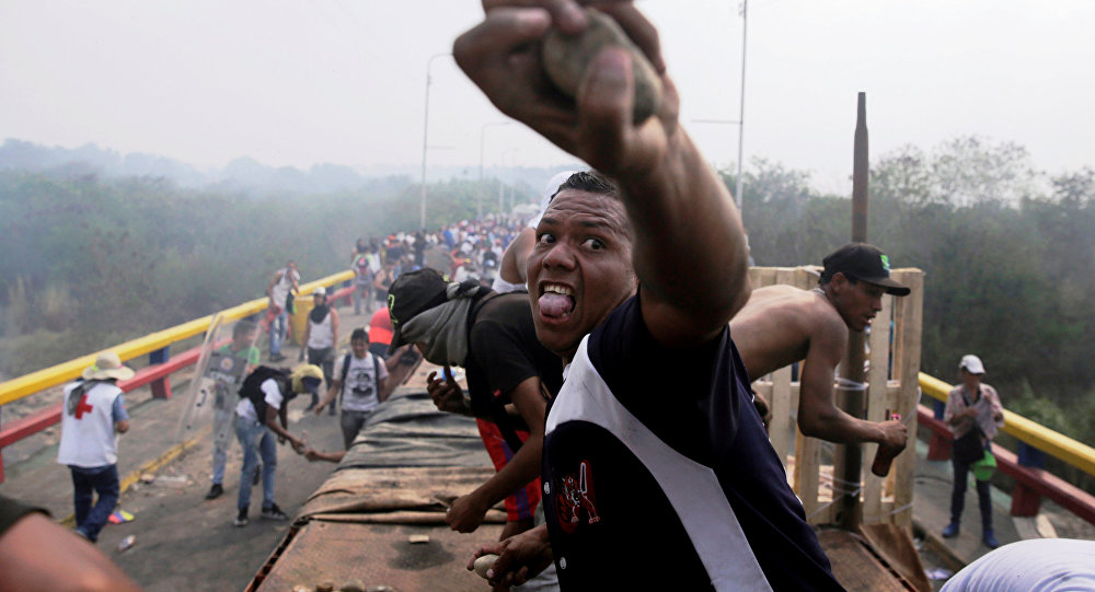 Opposition supporters clash with Venezuela's security forces at Francisco de Paula Santander bridge on the border line between Colombia and Venezuela as seen from Cucuta, Colombia, February 23, 2019