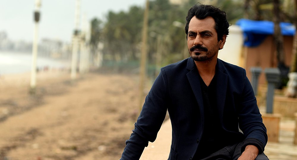 Indian Bollywood actor Nawazuddin Siddiqui poses during the promotion of the upcoming Hindi fim 'GENIUS' in Mumbai on August 17, 2018