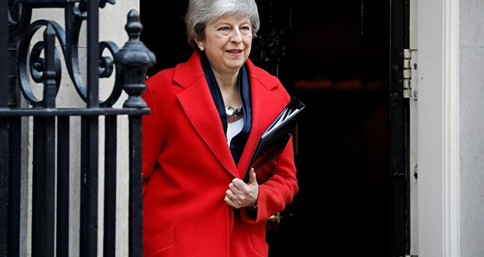 Theresa May leaves 10 Downing Street on her way to Parliament to offer MPs a vote on whether to leave the EU without a deal