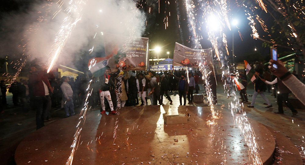 People burn firecrackers to celebrate after Indian authorities said their jets conducted air strikes on militant camps in Pakistani territory in New Delhi India