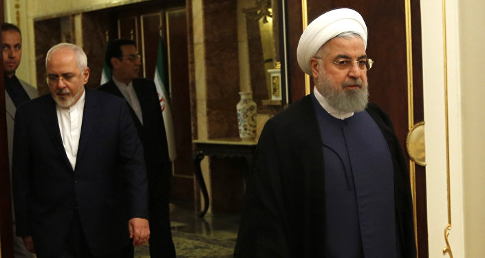 Iranian President Hassan Rouhani arrives to a meeting with the North Korean foreign minister in the capital Tehran on August 8, 2018