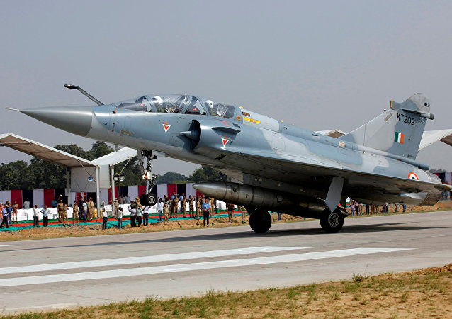 An Indian Air Force Mirage 2000 aircraft lands on the Agra-Lucknow expressway during a drill which, according to the Air Force officials, was held to use the expressway as landing strips in the event of emergency, in Unnao in the northern state of Uttar Pradesh, India, October 24, 2017