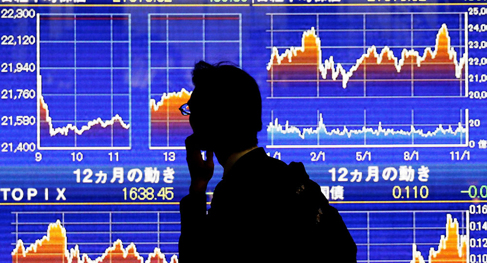 A man looks at an electronic stock quotation board showing Japan's Nikkei average outside a brokerage in Tokyo, Japan, November 13, 2018