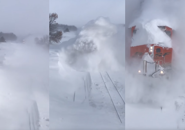 US Train Barrels Through Ground Blizzard