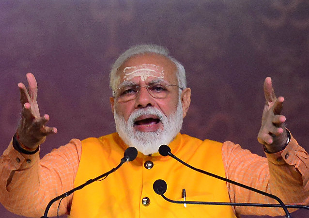 Indian Prime Minister Narendra Modi speaks during the Swachh Kumbh Swachh Aabhaar event organized by Ministry of Drinking Water & Sanitation at Ganga pandal during the Kumbh Mela festival in Allahabad on February 24, 2019