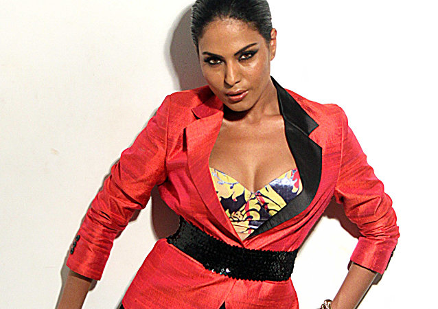 Pakistani actress Veena Malik poses during a promotional photo shoot in Mumbai on June 12, 2012