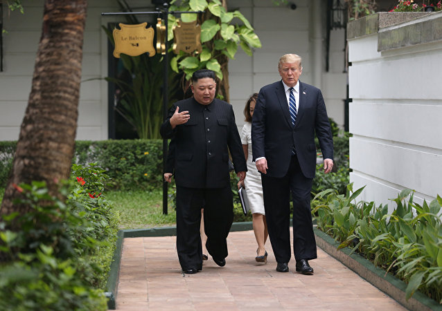 North Korea's leader Kim Jong Un and U.S. President Donald Trump talk in the garden of the Metropole hotel during the second North Korea-U.S. summit in Hanoi, Vietnam February 28, 2019