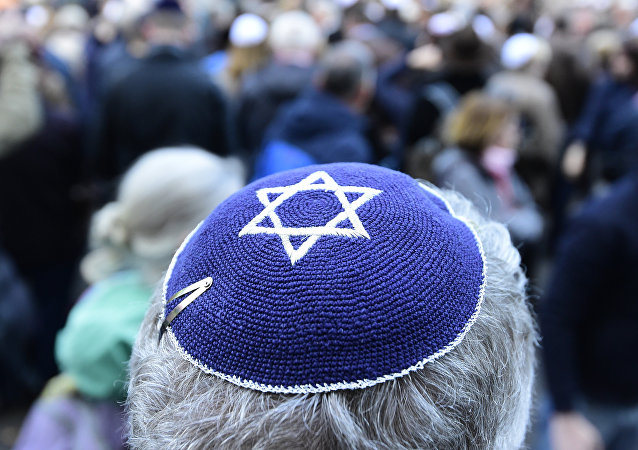 A participant of the Berlin wears kippa rally wears a kippa in Berlin