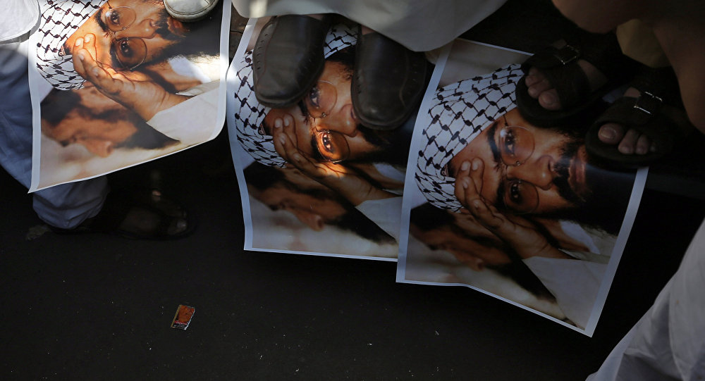 Demonstrators step on the posters of Maulana Masood Azhar, head of Pakistan-based militant group Jaish-e-Mohammad which claimed attack on a bus that killed 44 Central Reserve Police Force (CRPF) personnel in south Kashmir on Thursday, during a protest in Mumbai, India, February 15, 2019