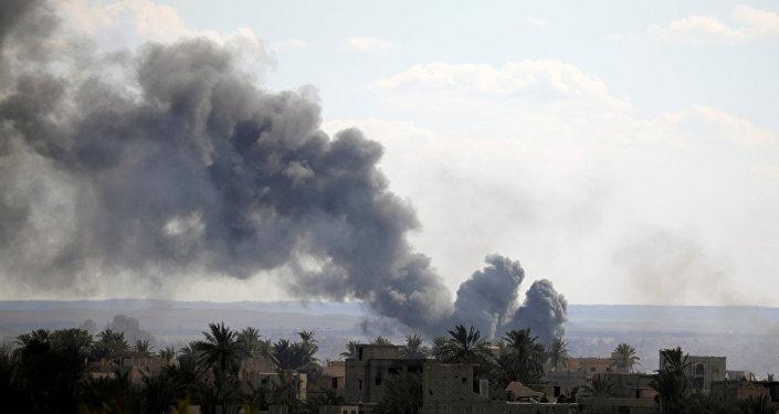 Black plumes of smoke rise in Baghouz, Deir Al Zor province