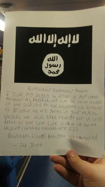 A letter, handwritten by Lewis Ludlow using the moniker The Ghost, and carrying a copy of the Daesh flag