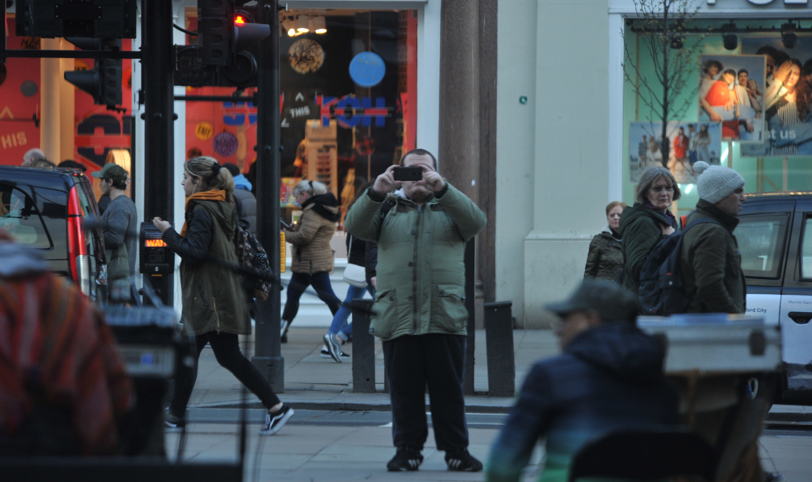 Lewis Ludlow, pictured taking photographs in Oxford Street as he carries out reconnaissance ahead of his planned attack