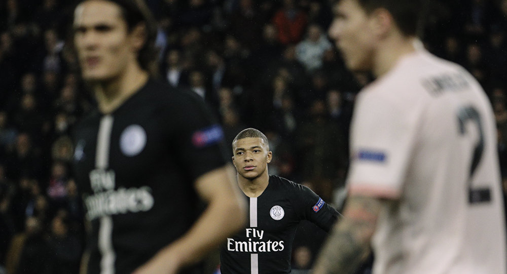 Paris Saint-Germain's French forward Kylian Mbappe (C) looks on during the UEFA Champions League round of 16 second-leg football match between Paris Saint-Germain (PSG) and Manchester United at the Parc des Princes stadium in Paris on March 6, 2019