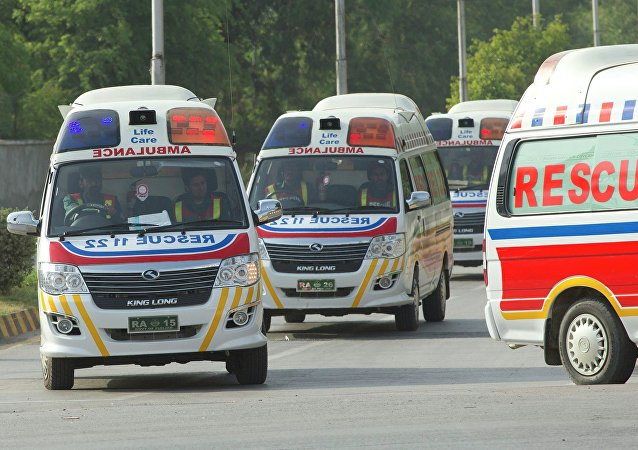 Ambulances carry the bodies of foreign tourists killed by unidentified gunmen at the base camp of the Nanga Parbat mountain, June 23, 2013
