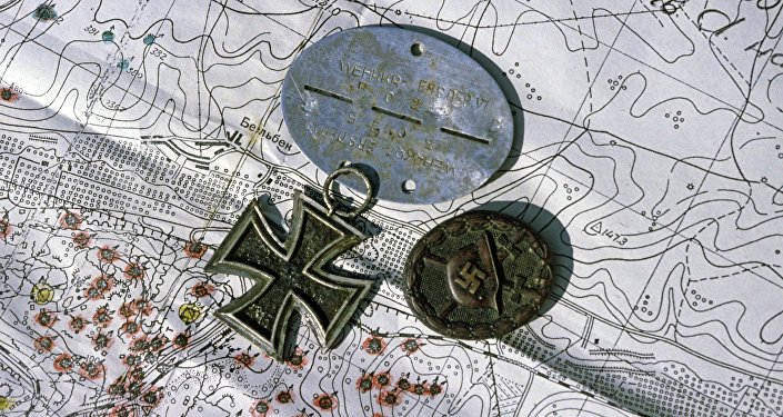 Nazi medals laid over map.