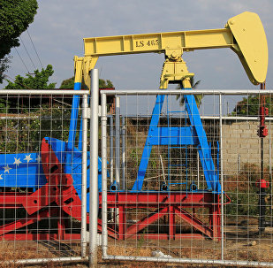 An oil pumpjack painted with the colors of the Venezuelan flag is seen in Lagunillas, Venezuela January 29, 2019