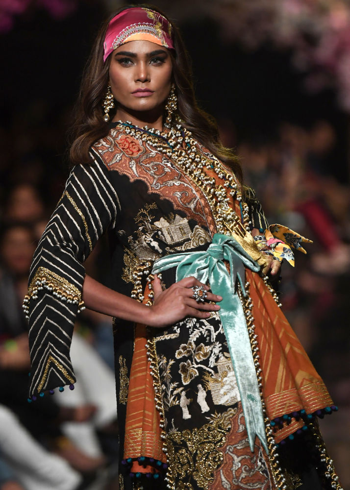 Model Presents Creation by Pakistani Designer Sana Safinaz During  Fashion Pakistan Week
