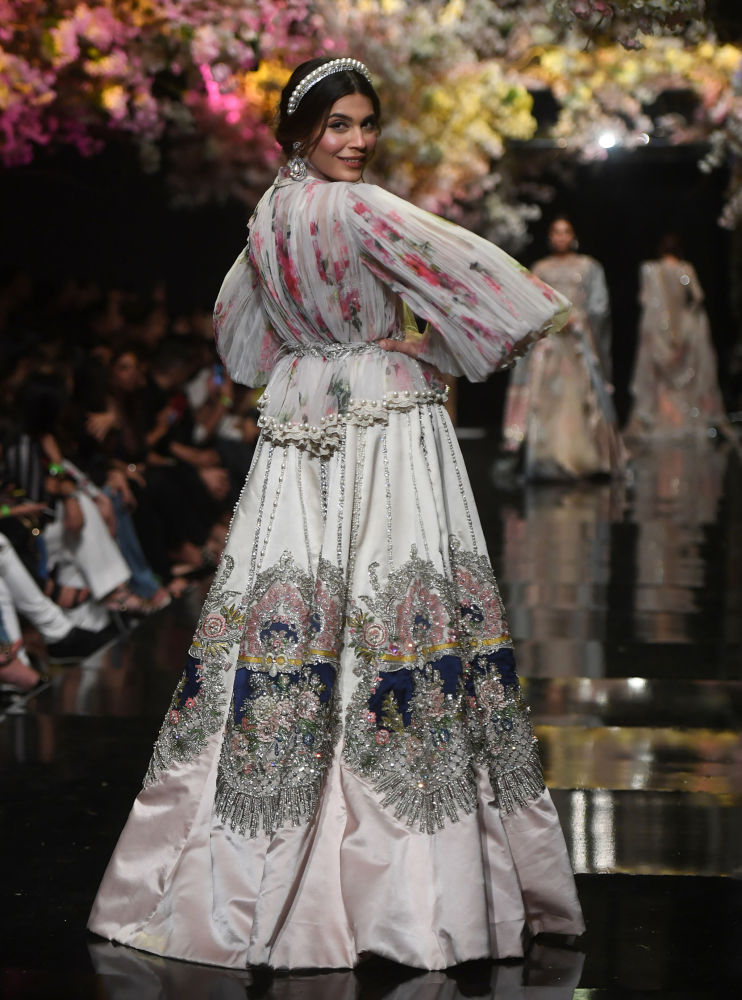 Models Present Creation by Pakistani Designer Sana Safinaz During the Fashion Pakistan Week