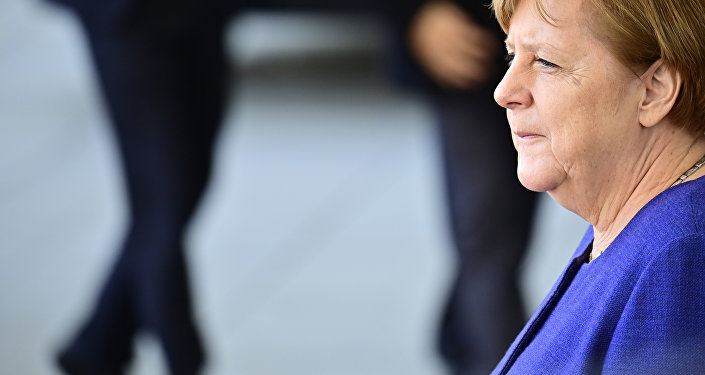 German Chancellor Angela Merkel waits for her guest, the Laotian Prime Minister, before a welcome ceremony and talks at the chancellery in Berlin on March 13, 2019