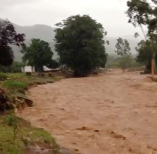 Flooding caused by Cyclone Idai is seen in Chipinge, Zimbabwe, March 16, 2019 in this still image taken from social media video
