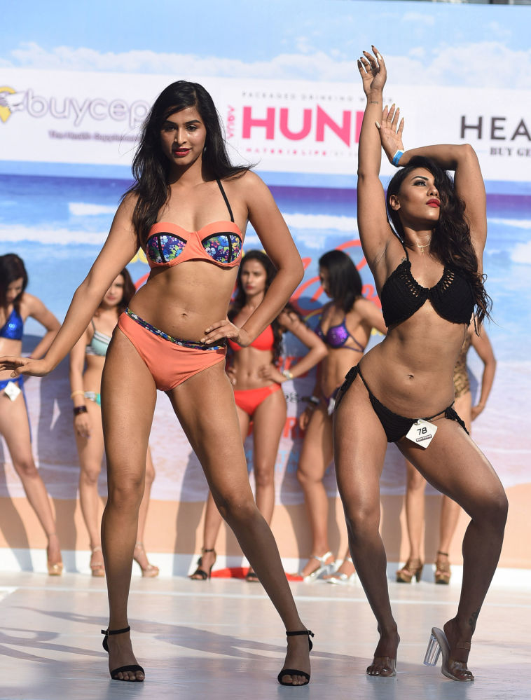 Indian female fitness models perform on stage during the 'Body Power Beach Show'