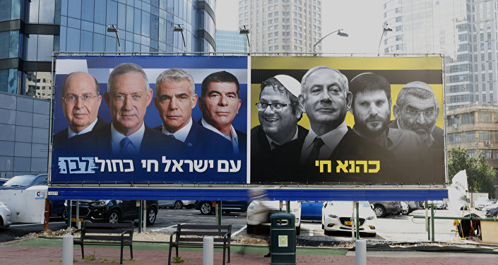 A picture taken on March 17, 2019 in the Israeli city of Ramat Gan in the suburbs of Tel Aviv shows a billboard bearing portraits of Blue and White (Kahol Lavan) political alliance leaders Moshe Yaalon, Benny Gantz, Yair Lapid and Gabi Ashkenazi, with a caption below reading in Hebrew The nation of Israeli lives; alongside another billboard showing Prime Minister Benjamin Netanyahu flanked by extreme right politicians Itamar Ben Gvir, Bezalel Smotrich and Michael Ben Ari, with another caption in Hebrew reading Kahana Lives in a reference to a banned ultranationalist party in the 1994.