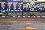 An Ultra-Orthodox Jewish man looks at an elections billboards of the Blue and White party leaders, from left to right, Moshe Yaalon, Benny Gantz, Yair Lapid and Gabi Ashkenazi, alongside a panel on the right showing Prime Minister Benjamin Netanyahu flanked by extreme right politicians, from the left, Itamar Ben Gvir, Bezalel Smotrich and Michael Ben Ari in Bnei Brak, Israel, Saturday, March 16, 2019. Hebrew reads on the left billboard The nation of Israel lives and on the right billboard Kahana Lives in a reference to a banned ultranationalist party in the 1994.