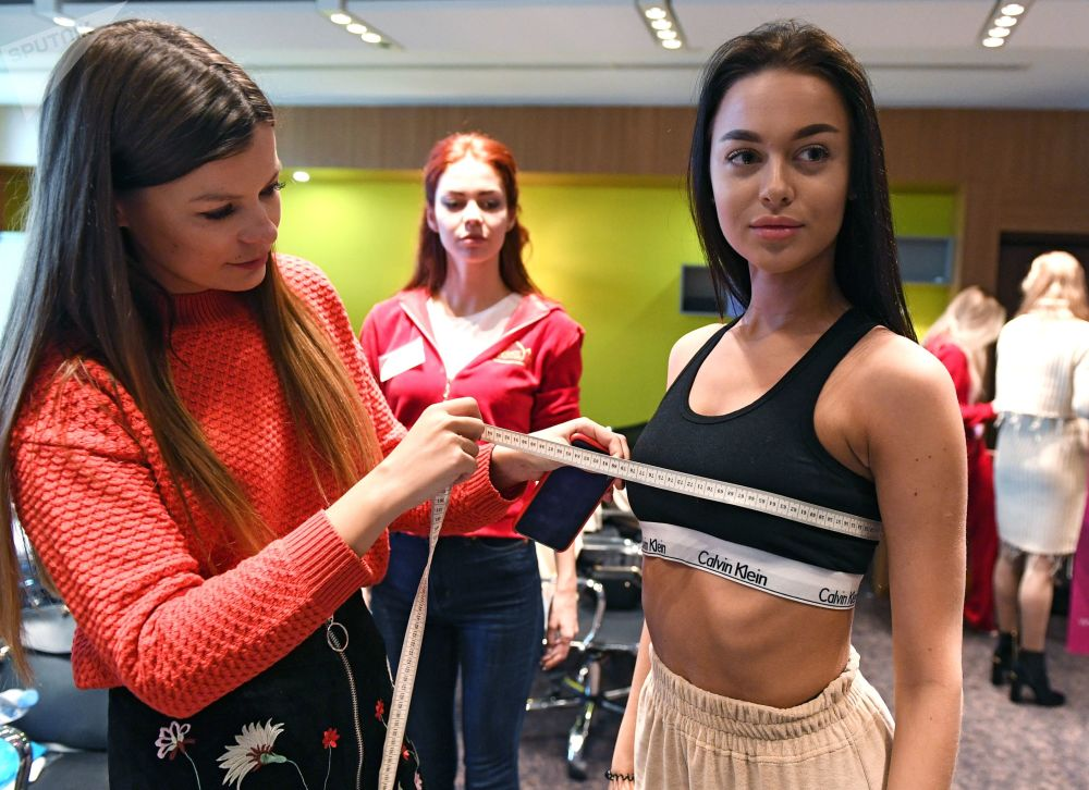 Woman Checks 'Miss Russia' Contestant's Measurements in Moscow