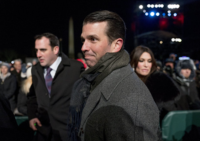 Donald Trump Jr., center, and Kimberly Guilfoyle, right, depart following the National Christmas Tree lighting ceremony at the Ellipse near the White House in Washington, Wednesday, Nov. 28, 2018