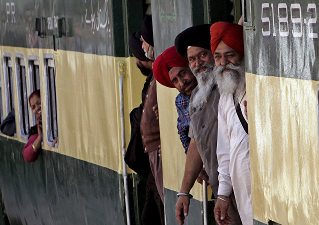 Indian Sikh pilgrims arrive at Wagha railway station to attend the birth anniversary of their spiritual leader Baba Guru Nanak, in Pakistan, Wednesday, Nov. 21, 2018